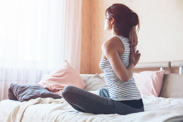 Woman-doing-yoga-exercise-on-bed-at-home-Morning-workout-in-bedroom-Healthy-and-sport-lifestyle_shutterstock_653291557.jpg
