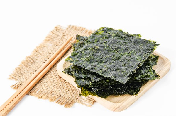 Japanese-food-nori-dry-seaweed-sheets-with-salt-and-chopsticks-on-white-background_shutterstock_578930458.jpg